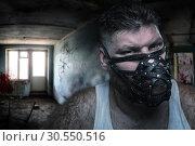 Man in muzzle. Стоковое фото, фотограф Tryapitsyn Sergiy / Фотобанк Лори