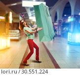 Купить «Woman holding huge shopping bag», фото № 30551224, снято 8 марта 2015 г. (c) Tryapitsyn Sergiy / Фотобанк Лори