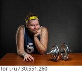 Купить «Man with a dumbbell», фото № 30551260, снято 10 марта 2015 г. (c) Tryapitsyn Sergiy / Фотобанк Лори