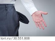 Купить «Businessman showing empty pockets», фото № 30551808, снято 8 сентября 2011 г. (c) Tryapitsyn Sergiy / Фотобанк Лори