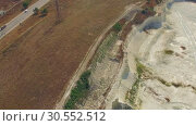 Купить «AERIAL VIEW. Driveway Near Emerald Lake In Open Quarry In Bakhchisarai, Crimea», видеоролик № 30552512, снято 17 сентября 2015 г. (c) Владимир Кравченко / Фотобанк Лори