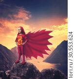Купить «Super hero girl in mountains», фото № 30553624, снято 16 июля 2019 г. (c) Tryapitsyn Sergiy / Фотобанк Лори