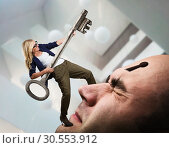 Купить «Woman with key on the man's face», фото № 30553912, снято 19 сентября 2015 г. (c) Tryapitsyn Sergiy / Фотобанк Лори