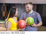 Couple with bowling balls. Стоковое фото, фотограф Tryapitsyn Sergiy / Фотобанк Лори