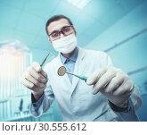 Купить «Dentist while working», фото № 30555612, снято 18 июня 2019 г. (c) Tryapitsyn Sergiy / Фотобанк Лори