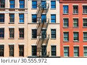 Купить «Facade of brick building with fire ladders.», фото № 30555972, снято 9 июня 2016 г. (c) Tryapitsyn Sergiy / Фотобанк Лори
