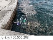 Купить «Garbage in water on pier.», фото № 30556208, снято 14 июня 2016 г. (c) Tryapitsyn Sergiy / Фотобанк Лори
