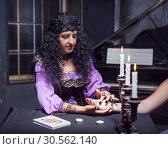 Купить «Sorceress reading somebody's hand», фото № 30562140, снято 27 июля 2016 г. (c) Tryapitsyn Sergiy / Фотобанк Лори