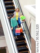 Купить «Women on the moving staircase», фото № 30562320, снято 9 сентября 2016 г. (c) Tryapitsyn Sergiy / Фотобанк Лори