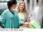 Купить «Women on the moving staircase», фото № 30562324, снято 9 сентября 2016 г. (c) Tryapitsyn Sergiy / Фотобанк Лори