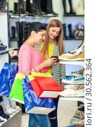 Купить «Women shopping», фото № 30562364, снято 9 сентября 2016 г. (c) Tryapitsyn Sergiy / Фотобанк Лори