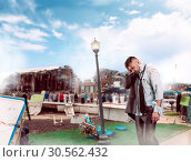 Купить «Man after wreckage», фото № 30562432, снято 7 июля 2016 г. (c) Tryapitsyn Sergiy / Фотобанк Лори