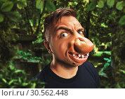 Купить «Man with an ugly face», фото № 30562448, снято 13 сентября 2016 г. (c) Tryapitsyn Sergiy / Фотобанк Лори