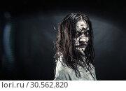 Купить «Zombie woman with bloody face», фото № 30562820, снято 8 октября 2016 г. (c) Tryapitsyn Sergiy / Фотобанк Лори