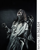 Купить «Zombie woman with bloody face», фото № 30562824, снято 8 октября 2016 г. (c) Tryapitsyn Sergiy / Фотобанк Лори
