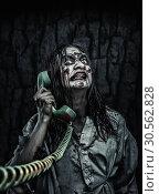 Купить «Horror zombie girl calling by phone», фото № 30562828, снято 8 октября 2016 г. (c) Tryapitsyn Sergiy / Фотобанк Лори