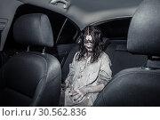 Купить «Horror zombie woman with bloody face in the car», фото № 30562836, снято 8 октября 2016 г. (c) Tryapitsyn Sergiy / Фотобанк Лори