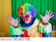Clown with queer expression on his face. Стоковое фото, фотограф Tryapitsyn Sergiy / Фотобанк Лори