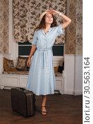 Купить «Young woman get ready on a journey.», фото № 30563164, снято 4 ноября 2016 г. (c) Tryapitsyn Sergiy / Фотобанк Лори