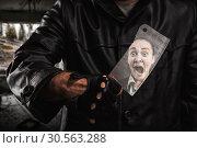Купить «Serial maniac standing under bridge with knife.», фото № 30563288, снято 7 ноября 2016 г. (c) Tryapitsyn Sergiy / Фотобанк Лори