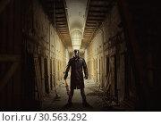 Купить «Killer with bloody bat in abandoned building.», фото № 30563292, снято 7 ноября 2016 г. (c) Tryapitsyn Sergiy / Фотобанк Лори