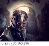 Купить «Serial maniac in hockey mask at torture chamber», фото № 30563296, снято 7 ноября 2016 г. (c) Tryapitsyn Sergiy / Фотобанк Лори
