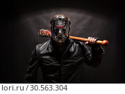 Купить «Psycho killer in hockey mask on black background.», фото № 30563304, снято 7 ноября 2016 г. (c) Tryapitsyn Sergiy / Фотобанк Лори