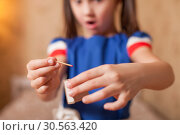 Купить «Little girl playing dangerous game with matches», фото № 30563420, снято 24 ноября 2016 г. (c) Tryapitsyn Sergiy / Фотобанк Лори