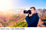 Photographer taking picture of rocky mountains. Стоковое фото, фотограф Tryapitsyn Sergiy / Фотобанк Лори