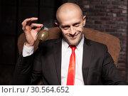 Купить «Killer in suit and tie ready to pull a grenade pin», фото № 30564652, снято 19 января 2017 г. (c) Tryapitsyn Sergiy / Фотобанк Лори