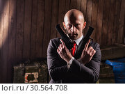 Купить «Bald contract killer in suit with two pistols», фото № 30564708, снято 19 января 2017 г. (c) Tryapitsyn Sergiy / Фотобанк Лори