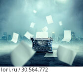 Vintage typewriter, urban landscape on background. Стоковое фото, фотограф Tryapitsyn Sergiy / Фотобанк Лори