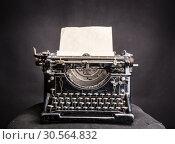 Купить «Vintage black typewrite with inserted paper sheet», фото № 30564832, снято 25 января 2017 г. (c) Tryapitsyn Sergiy / Фотобанк Лори
