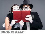 Купить «Two comedy performers posing with book», фото № 30565124, снято 12 февраля 2017 г. (c) Tryapitsyn Sergiy / Фотобанк Лори