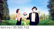 Купить «Mime actors performing with flower bouquet», фото № 30565132, снято 12 февраля 2017 г. (c) Tryapitsyn Sergiy / Фотобанк Лори