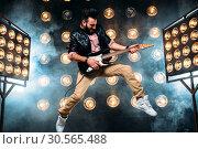 Купить «Male pop star with electro guitar», фото № 30565488, снято 2 марта 2017 г. (c) Tryapitsyn Sergiy / Фотобанк Лори