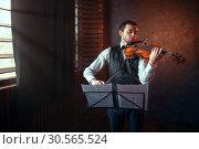 Купить «Male violinist playing classical music on violin», фото № 30565524, снято 4 марта 2017 г. (c) Tryapitsyn Sergiy / Фотобанк Лори