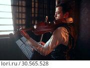 Купить «Male fiddler playing classical music on violin», фото № 30565528, снято 4 марта 2017 г. (c) Tryapitsyn Sergiy / Фотобанк Лори