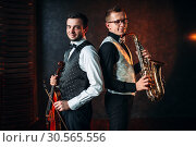 Saxophonist with sax and violinst with violin duet. Стоковое фото, фотограф Tryapitsyn Sergiy / Фотобанк Лори