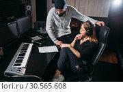 Купить «Female singer listen song record in music studio», фото № 30565608, снято 21 февраля 2017 г. (c) Tryapitsyn Sergiy / Фотобанк Лори