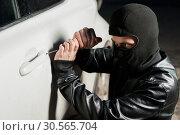 Купить «Male thief hands open car door with screwdriver», фото № 30565704, снято 17 марта 2017 г. (c) Tryapitsyn Sergiy / Фотобанк Лори