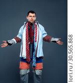 Купить «Male buyer dressed in many clothes», фото № 30565868, снято 18 марта 2017 г. (c) Tryapitsyn Sergiy / Фотобанк Лори