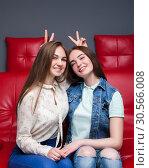 Купить «Female friendship, leisure of happy girls», фото № 30566008, снято 23 марта 2017 г. (c) Tryapitsyn Sergiy / Фотобанк Лори