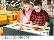 Купить «Little kids having fun on attractions», фото № 30566348, снято 12 апреля 2017 г. (c) Tryapitsyn Sergiy / Фотобанк Лори