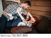 Купить «Man beats woman, domestic violence, quarrel», фото № 30567484, снято 19 июля 2017 г. (c) Tryapitsyn Sergiy / Фотобанк Лори