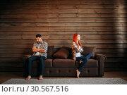 Купить «Family quarrel, couple do not talk, conflict», фото № 30567516, снято 19 июля 2017 г. (c) Tryapitsyn Sergiy / Фотобанк Лори