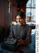 Купить «Woman with old fashion style beads in her hands», фото № 30567756, снято 20 августа 2017 г. (c) Tryapitsyn Sergiy / Фотобанк Лори
