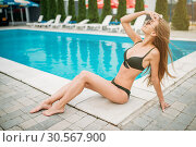 Купить «Sexy girl in swimwuit near the swimming pool», фото № 30567900, снято 21 августа 2017 г. (c) Tryapitsyn Sergiy / Фотобанк Лори