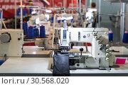 Купить «Sewing factory, nobody, overlock machines», фото № 30568020, снято 7 сентября 2017 г. (c) Tryapitsyn Sergiy / Фотобанк Лори