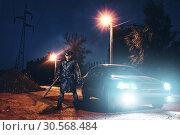 Купить «Maniac with bloody baseball bat against black car», фото № 30568484, снято 22 сентября 2017 г. (c) Tryapitsyn Sergiy / Фотобанк Лори